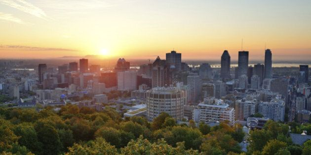 Montreal sunrise viewed from Mont Royal with city skyline in the