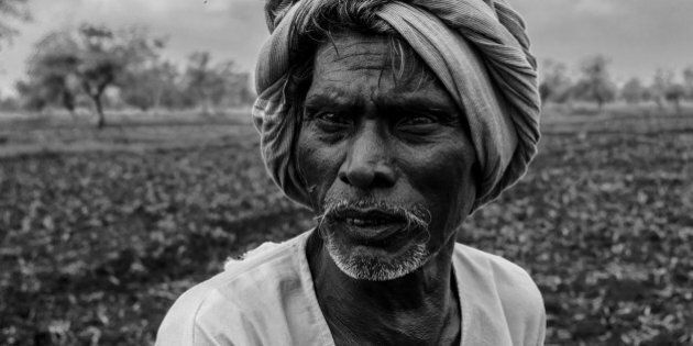 Black and white portrait of aged Indian