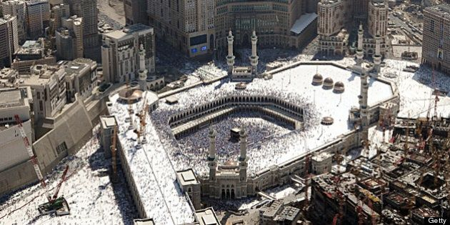 An aerial view shows the Abraj al-Bait Towers also known as the Mecca Royal Hotel Clock Tower, over shadows...