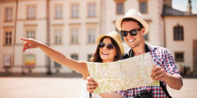 Happy tourist sightseeing city with