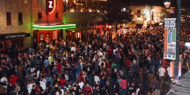 AUSTIN, TX - MARCH 15: Crowds of festival music fans on 6th Street during Day 4 of SXSW 2013 Music Festival...
