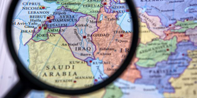 Syria and the Middle East seen through a magnifying glass, which helps focus on certain