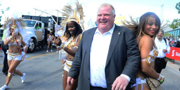 TORONTO, ON - AUGUST 3 - The Mayor ,Rob Ford showed up late and missed the ribbon cutting with the premier but managed a dance with some of the revellersThe Scotiabank Caribbean Carnival,Known as th the Caribana Parade  took over the Exhibition  Grounds and the Lakeshore with lots of music and colorful costumes The Grand parade went from 10am in the morning until 6pm at night with people and families attending from  all over the country attending Toronto,        (Colin McConnell/Toronto Star via Getty Images)