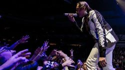 WATCH: Arcade Fire Stop Concert To Help Distressed