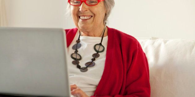 Elderley woman using tablet and laptop computers