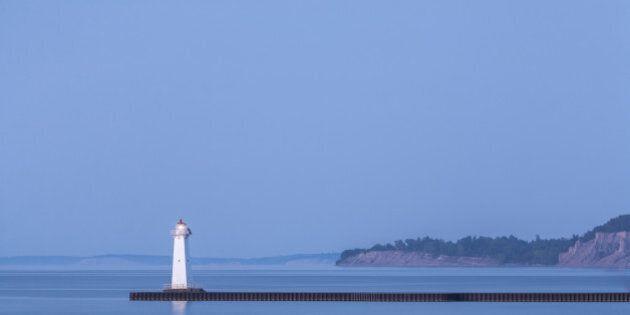 Dreamy ethereal blue dusk on Lake Ontario. Sodus Point Pierhead Lighthouse, NY, Lake Ontario, Pantone...