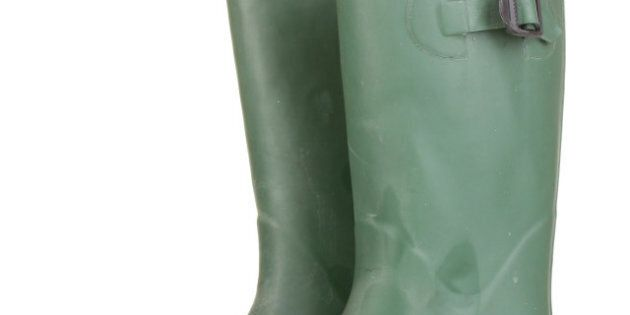 green gumboots isolated on