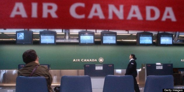 A passenger waits for the Air Canada check-in counter to open at terminal 1 of the Toronto Pearson Airport....