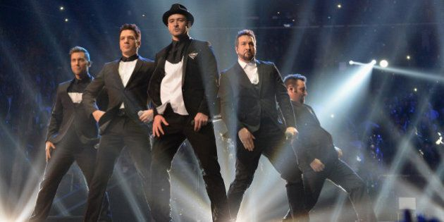 NEW YORK, NY - AUGUST 25: (L-R) Lance Bass, JC Chasez, Justin Timberlake, Joey Fatone and Chris Kirkpatrick of N Sync perform during the 2013 MTV Video Music Awards at the Barclays Center on August 25, 2013 in the Brooklyn borough of New York City. (Photo by Jeff Kravitz/FilmMagic for MTV)