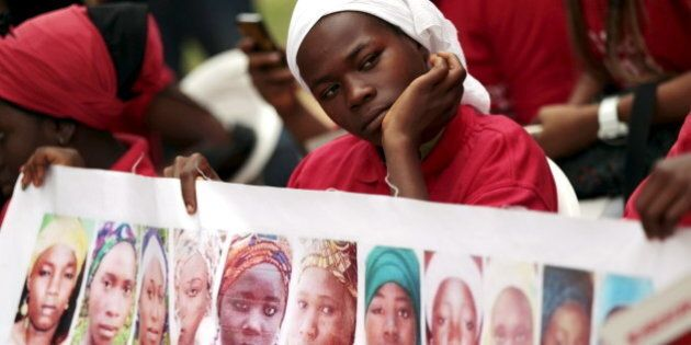 Bring Back Our Girls (BBOG) campaigners look on during a protest procession marking the 500th day since...