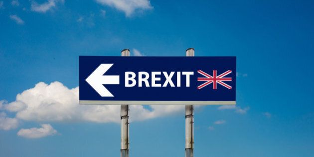 a road signs EU and BREXIT and a blue