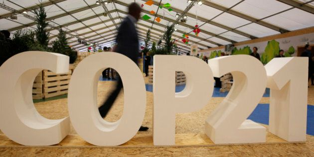A man visits the Climate Generations Areas, part of the COP21, the United Nations Climate Change Conference...