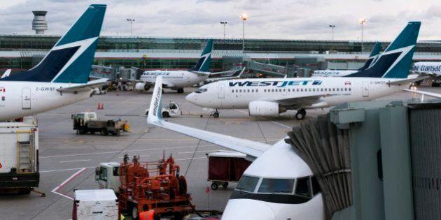 WestJet Mulls Baggage Fees As Canadian Dollar Falls, Air Fares