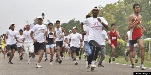 NEW DELHI, INDIA - JULY 11: School children participate in a walkathon held to mark ''World Population...