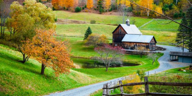 Fall foliage, New England countryside at Woodstock, Vermont, farm in autumn landscape. Old wooden barn...