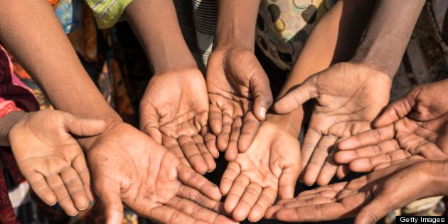 Poor children in Ethiopia with outstretched hands asking for money. Some unrecognizable