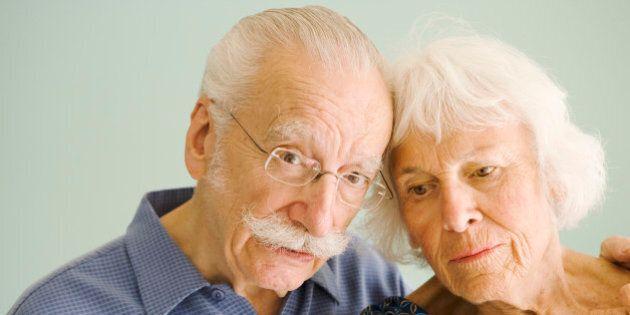 Worried senior couple