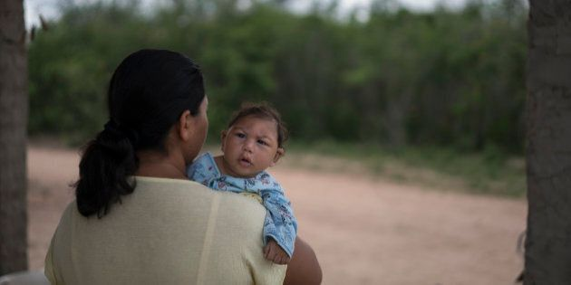 Josiane da Silva holds her son Jose Elton, who was born with microcephaly, outside her house in Alcantil,...