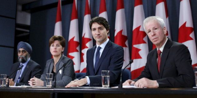 Canada's Prime Minister Justin Trudeau (2nd R) takes part in a news conference with Defence Minister...