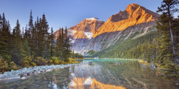 Mount Edith Cavell reflected in Cavell Lake in Jasper National Park, Canada. Photographed at