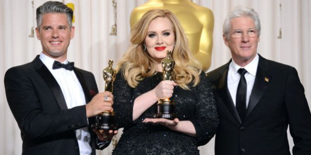 HOLLYWOOD, CA - FEBRUARY 24: (L-R) Songwriter Paul Epworth and singer Adele, winners of the Best Original...