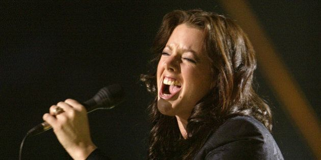 EDMONTON - APRIL 4: Singer Sarah McLachlan performs onstage at the 2004 Juno Awards at Rexall Place on April 4, 2004 in Edmonton, Alberta, Canada. The Junos celebrate excellence in Canadian music. (Photo by Carlo Allegri/Getty Images)