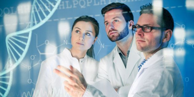 Genetic engineering. Group of scientists working at the
