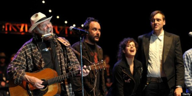 MOUNTAIN VIEW, CA - OCTOBER 22: Musicians Neil Young and Dave Matthews perform with Régine Chassagne and Win Butler of Arcade Fire at the 25th Annual Bridge School Benefit Concert at Shoreline Amphitheatre on October 22, 2011 in Mountain View, California. (Photo by John Shearer/WireImage)