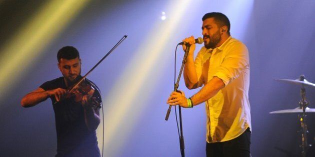 Hamed Sinno (R) and Haig Papazian of Lebanese alternative rock band Mashrou' Leila perform on stage at...