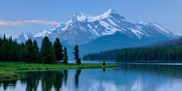 Mt Charlton and Mt Unwin reflected in Maligne Lake at dawn, Jasper National Park, Alberta, Canada