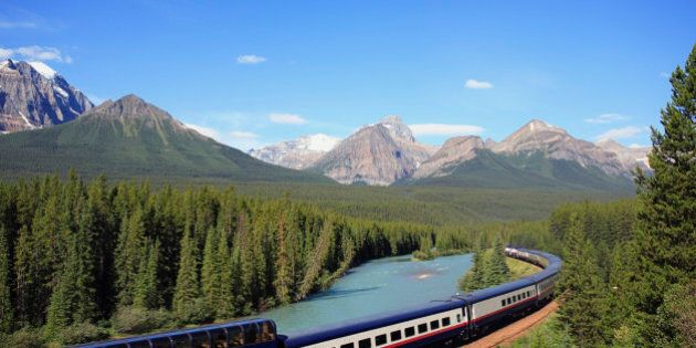 The Rocky Mountaineer tourist passenger train at Morant's Curve on the CPR line along the Bow River near...