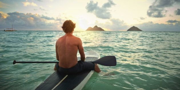 Caucasian man on paddle board in