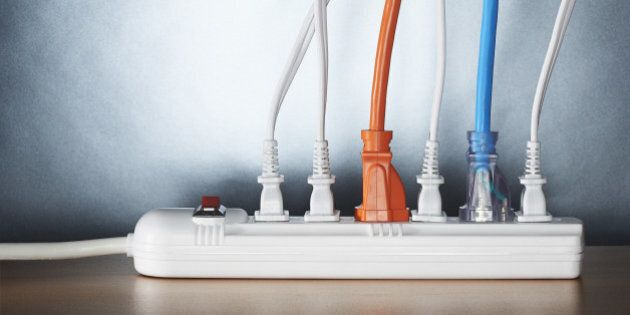 Close up of cords plugged into power