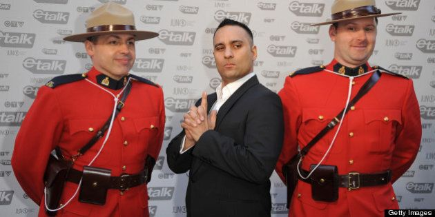 VANCOUVER - MARCH 29: Host of the 2009 Junos, Russell Peters (M) attends the 2009 Juno Awards at General Motors Place on March 29, 2009 in Vancouver, British Columbia, Canada. (Photo by George Pimentel/WireImage)