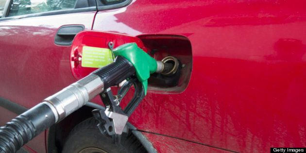 Car filling up at gas