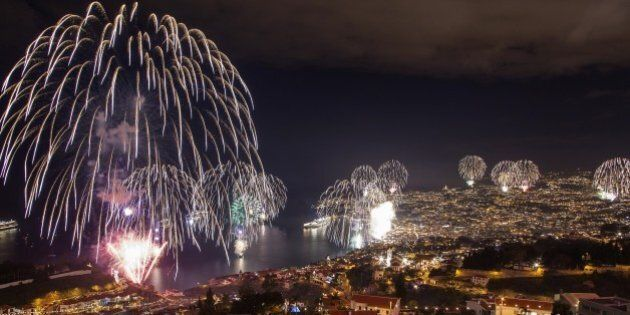 Fireworks light up the sky above Funchal Bay, Madeira Island, to celebrate the arrival of the New Year...