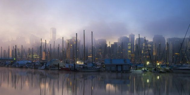 Early morning view over the marina and waterfront and mist