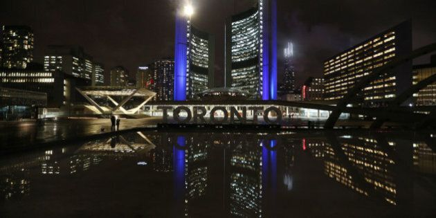 TORONTO, ON- MARCH 22: The Toronto sign by the reflecting pool in Nathan Phillips Square is turned off...