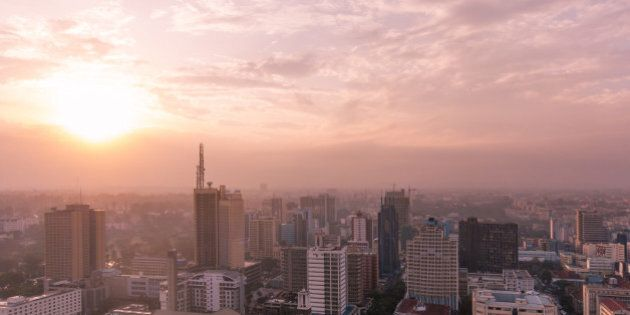 View over Nairobi central business district. Photo has a pink and purple tone. English-style clock tower of Kenya's Parliament House visible (lower middle).