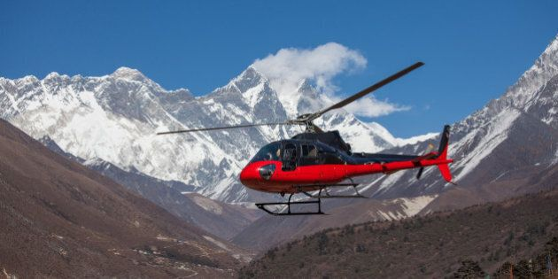 Lifeguard helicopter in Himalaya mountains in