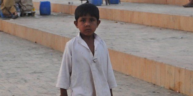A Pakistani child sells beverages on a beach in Karachi on March 21, 2012 on the eve of the UN World...