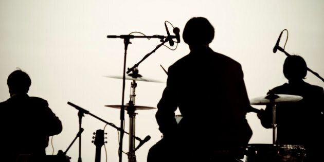 This is a silhouette of a Beatles cover band playing on Pensacola Beach for 'Bands on the Beach'. Of...