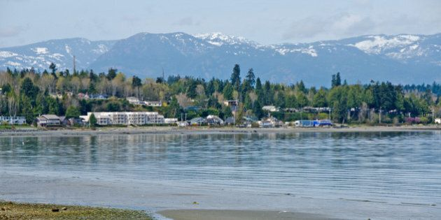Looking across Qualicum Bay towards Qualicum Beach on Vancouver Island. A tourism and retirees