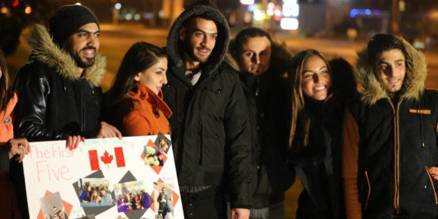 MISSISSAUGA, ON- DECEMBER 11:  Christine Youssef, second from right and George Hababeh, third from the right, are excited to reunite with their cousins. Syrian refugees begin to arrive in Canada at a hotel  near Pearson International Airport in Mississauga. December 11, 2015.        (Steve Russell/Toronto Star via Getty Images)