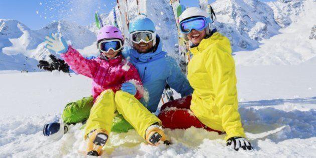 Skiing, winter, snow,  skiers, sun and fun - family enjoying winter vacationsSkiing family winter, snow,  skiers, sun and fun.