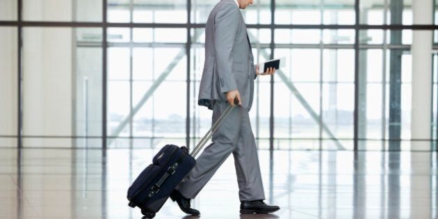 Low section of businessman walking at