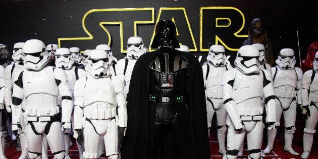 Actors dressed as Stormtroopers and Darth Vader pose for photographers upon arrival at the European premiere...