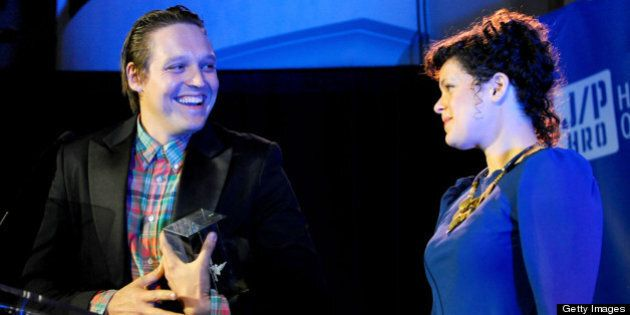 LOS ANGELES, CA - JANUARY 14: Musicians Win Butler(L) and Regine Chassagne of Arcade Fire speak onstage...