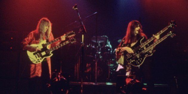 circa 1980: Canadian rock band Rush take the stage fronted by guitarist Alex Liefson (left) with singer...