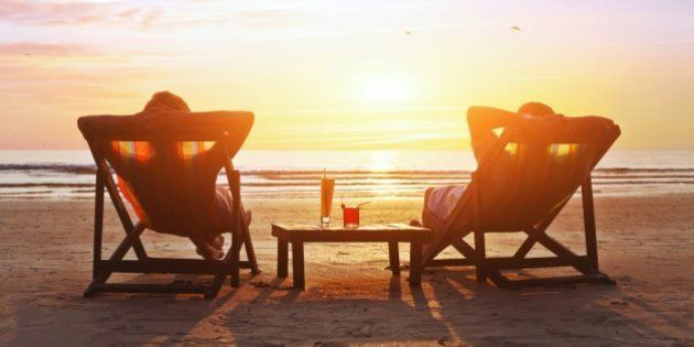 happy couple enjoy luxury sunset on the beach during summer